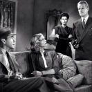 Lauren Bacall, Humphrey Bogart, Sonia Darrin, y Louis Jean Heydt en The Big Sleep (1946) Still 124